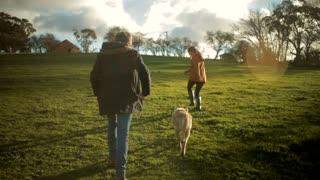 Man Woman run with dog