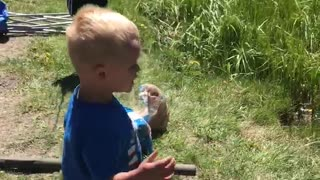 Ecstatic Little Boy Reels in First Fish