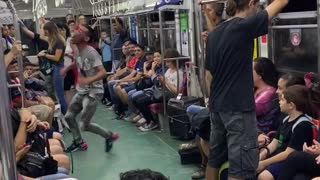 """Subway performer dances in subway train with rollerskates to little mermaid song """"under the sea"""""""