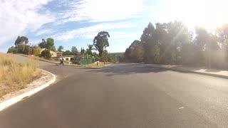 Pov skateboard long board street fail runs into side walk grass