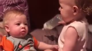 Toddler hilariously attempts to bottle feed baby brother hhhhhhh funny