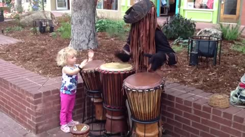3-Year-Old Toddler Joins Street Performer In Colorado
