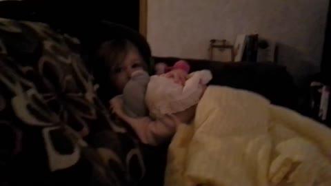 Emma rocks the baby