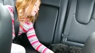 Sweet Girl Sings Her Puppy To Sleep