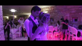 Professional dancers pull off dazzling routine at their wedding