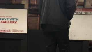 Man black jacket charging phone on roof