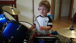 A young 2 year old toddler drummer