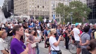 """New York teacher chant """"save New York"""" in opposition to vaccine mandates."""