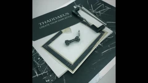 Studded Black Dog Bone Silver Pendant