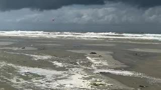 Insane jump of kite surfer.