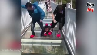 People are terrified to cross glass bridge   Glass bridge crack effect   Glass bridge funny moments