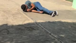 Skater runs onto skateboard and falls
