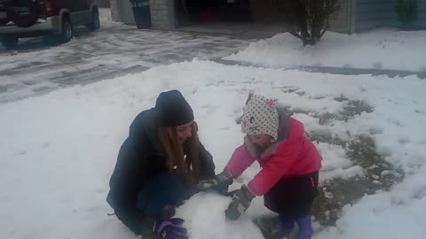 Emma and Aunt Shayleigh play in snow #3