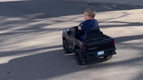 Baby Leo driving Chevy Silverado