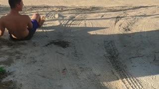 Teen boy backflips off car and misses landing