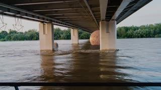 Planets Float by Under Bridge