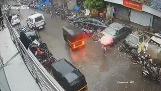 Woman dodges falling tree during cyclone