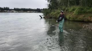 Landing a Kenai river red salmon.