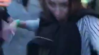 Music girl at concert falls backwards onto ground singing guitar