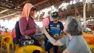 Chacala Beach Mexico! Akaisha buys earrings from beach vendor