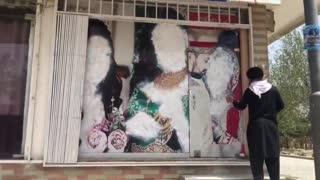 Taliban Spray Painting Women Faces Kabul