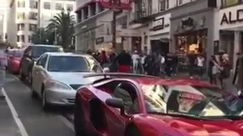 Guy jumps On A Lamborghini Aventador Twice And Gets Delt With!