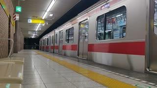 Tokyo Subway Train Pulls Into Shin-Sakuradai Station (bench view)