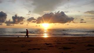 Couple Lovers Cross Beach In Sun Down View