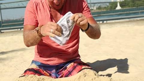Man Digging Money
