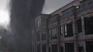 Tornado caught on camera close to the building, fake or real ?