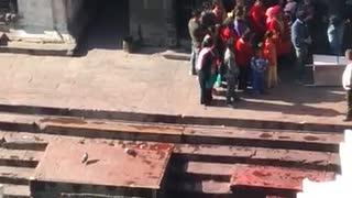 Pyre funeral ceremony, burning a corpse in Bagmati River, Pashupatinath Temple, Kathmandu 4