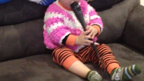 Toddler's karaoke attempt