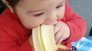 Cutest baby boy ever chows down on tasty banana