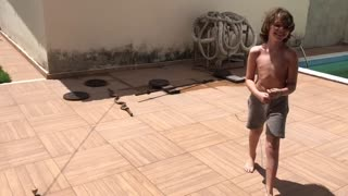 Boy playing a diferent Brazilian game.