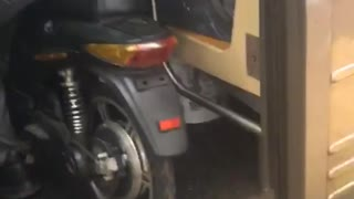 Man takes his motorcycle bike into a crowded subway train