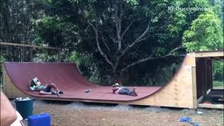 Skateboard half pipe jousting