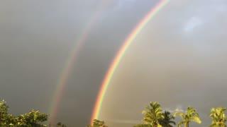 Double Rainbow Stretches across India Sunset