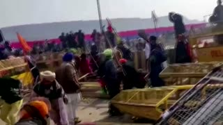 Indian police fire tear gas at farmers' protest