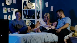 Happy family gathers watching TV