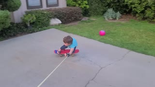 Father Helps Son Skateboard at Home During Quarantine