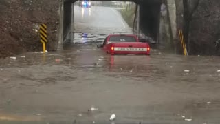 Truck Tries to Cross Flooded Underpass