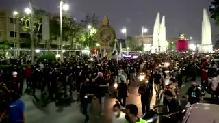 Thai protesters hurl paint, firecrackers at police