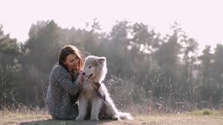 Adorable moment loving warmness with dog