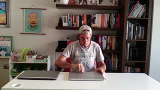 Man Types away on Disposable Laptops