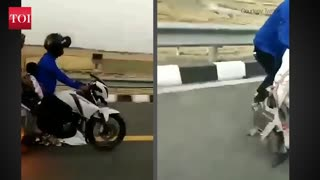 Miraculous escape for couple fire on a bike- exclusive video