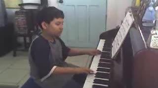 Pre-teen Nico practicing piano (Part 1)