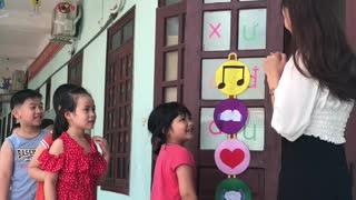 Teacher Greets Her Kindergarten Students in an Adorable Way