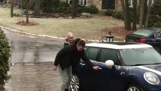 Teamwork Helps Navigate Super Slippery Driveway