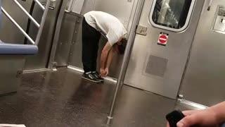 Drunk guy jumps and walks around in subway train
