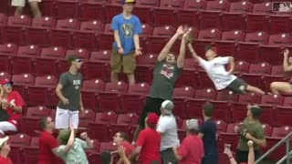 Young Fan makes a spectacular catch on a Joey Votto home run